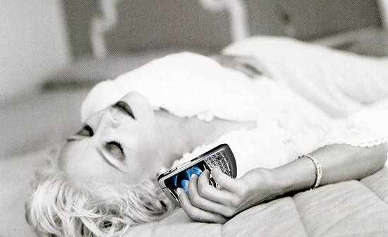 Madonna en haar Blackberry
